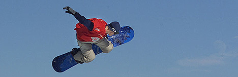 Snowboarder doing a grab